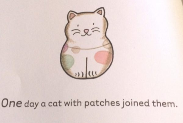 One day a cat with patches joined them.
