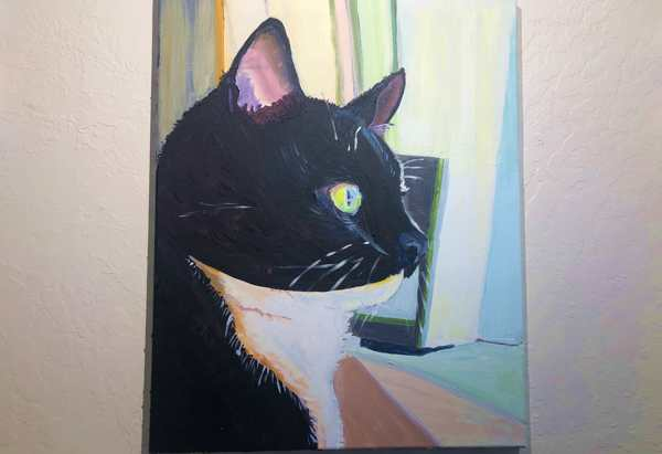 Acrlyclic wip showing a tuxedo cat in profile