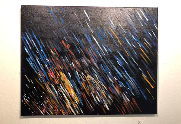 Abstract painting of streaks of light in different colors