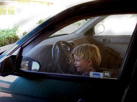 My son, age 2 prentending to drive my car.